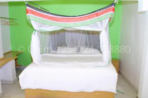 A bed or beds in a room at Osim Country Lodge