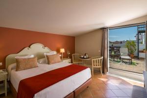 Cama o camas de una habitación en Vincci La Rabida