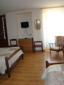 Un ou plusieurs lits dans un hébergement de l'établissement Hotel du Lion Vert