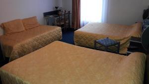 A bed or beds in a room at Logis de la Barque