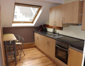 Virtuvė arba virtuvėlė apgyvendinimo įstaigoje Boardinghouse Castell