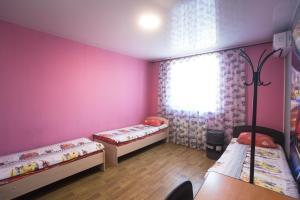 Кровать или кровати в номере Hostel Garage
