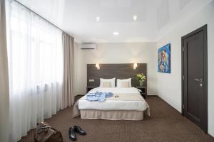 Кровать или кровати в номере SPA Hotel Galera