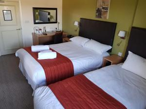 A bed or beds in a room at Rose And Crown