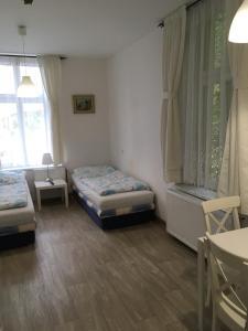 Ein Bett oder Betten in einem Zimmer der Unterkunft TopApartmany Lesni