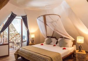 A bed or beds in a room at Villa Kiva Boutique Hotel