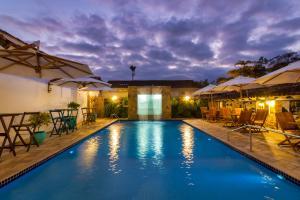A piscina localizada em Pousada Aconchego ou nos arredores
