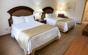 Ein Bett oder Betten in einem Zimmer der Unterkunft Best Western PLUS Monterrey Colon