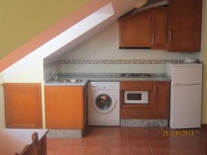 Una cocina o zona de cocina en Apartamentos Puente La Molina