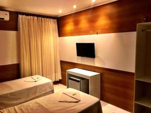 A bed or beds in a room at Hotel Terra do Sal