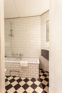 A bathroom at Avenue Boutique Hotel - Meeting room