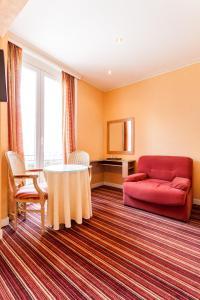 Ein Sitzbereich in der Unterkunft Malecot Boutique Hotel