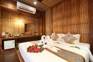 A bed or beds in a room at Railay Village Resort-SHA Plus