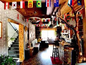 A restaurant or other place to eat at The Silk Road Travelers Hostel