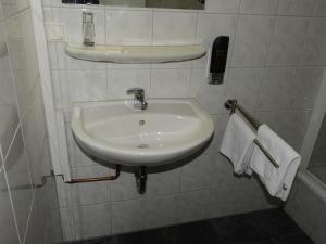 Ein Badezimmer in der Unterkunft La Chacra Pension