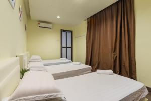 A bed or beds in a room at Amethyst Love Guesthouse