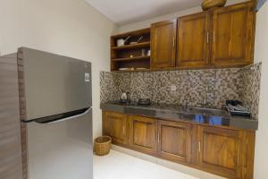 A kitchen or kitchenette at Sweet Ginger Villa by Prasi