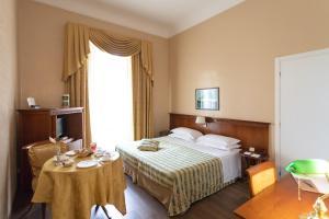 Кровать или кровати в номере Excelsior Palace Hotel