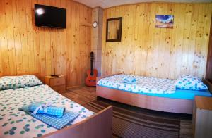 A bed or beds in a room at Holiday Home La Sierra with POOL