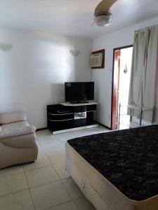 A television and/or entertainment center at Porto Dourado, G2