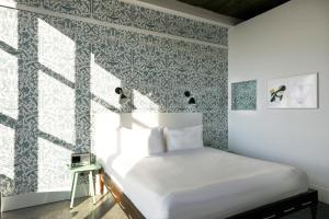 A bed or beds in a room at Wythe Hotel