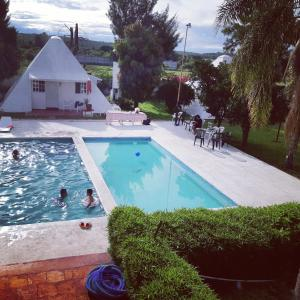 Vista de la piscina de Hotel Villa Piramidal o alrededores