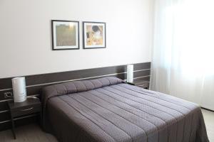 Letto o letti in una camera di Hotel Residence Aurora