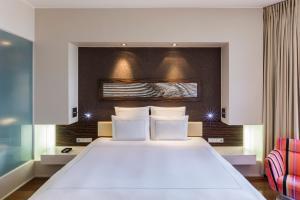 Ein Bett oder Betten in einem Zimmer der Unterkunft Swissotel Tallinn