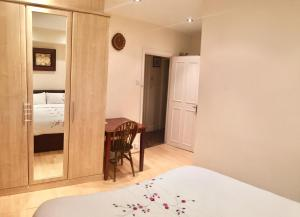 A bed or beds in a room at Beresford Road London Rooms