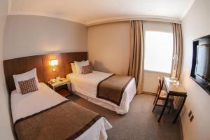 Cama o camas de una habitación en Hotel Martín Gusinde