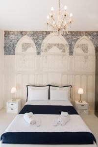 A bed or beds in a room at Relais Mareluna - Luxury Apartments