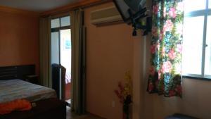 A bed or beds in a room at Residencial Recanto dos Pássaros