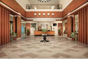 The lobby or reception area at Aston Tanjung City Hotel