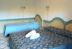 Cama o camas de una habitación en Residence Porto Mannu