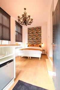 A bed or beds in a room at Ververs slapen