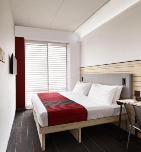 Cama ou camas em um quarto em Pod Times Square