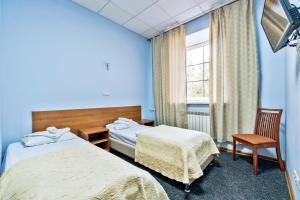 Кровать или кровати в номере Лоукост-отель Берисон Худякова