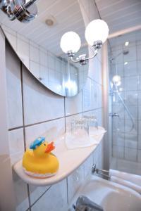 Ein Badezimmer in der Unterkunft Hotel Hecht Garni