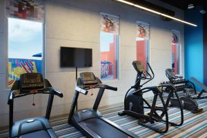 The fitness center and/or fitness facilities at Aloft Dubai South