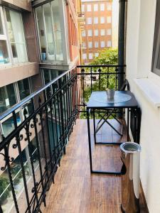A balcony or terrace at Urban Rooms