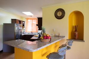 A kitchen or kitchenette at RESERVA CONCHAL Luxury Condo