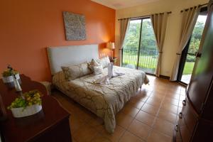 A bed or beds in a room at RESERVA CONCHAL Luxury Condo