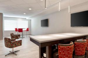 A television and/or entertainment center at Days Inn & Suites by Wyndham Denver International Airport