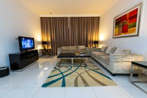 A seating area at Blue Ocean Holiday Homes - Capital Bay Towers
