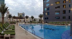 The swimming pool at or near Blue Ocean Holiday Homes - Capital Bay Towers