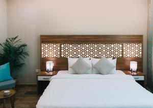 Cama ou camas em um quarto em فندق جمانه