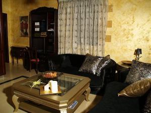 Χώρος καθιστικού στο Palazzo Loupassi Boutique Villas