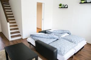 A bed or beds in a room at Sunny Aircon Apartment in the Centre of Slaný
