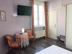 TV/Unterhaltungsangebot in der Unterkunft Hotel Claridge