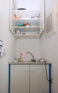 A kitchen or kitchenette at Smaragda Rooms & Studios
